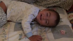 Cute little child is waking up smiling- Stock Footage