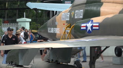 People look at American fighter jet from the Vietnam war in museum Saigon Stock Footage