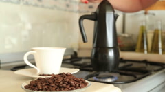 Moka pot brewing coffee on a stove Stock Footage