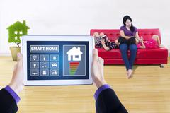 Smart home applications and happy family concept Stock Photos