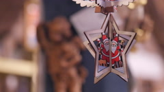 Wooden Santa Claus decoration hanging at the Christmas market in Nuremberg - stock footage