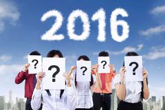 Unknown people with question sign and number 2016 - stock photo