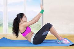 Woman doing exercise and sit up at home Stock Photos