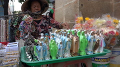 Vietnamese woman sells Virgin Mary and Jesus Christ statues in Saigon - stock footage