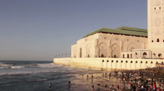 View on seafront of Grande Mosquee Hassan II in Casablanca Stock Footage