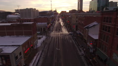 4k Aerial Snow Nashville Downtown 010. PART 1 Dusk Low Fly Over Broadway. Stock Footage