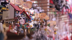 Wooden clock-houses hanging at the Christmas market in Nuremberg - stock footage