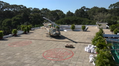 American Huey helicopter on standby on roof Independence Palace, Saigon, Vietnam Stock Footage