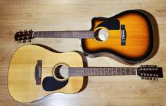two acoustic guitars - stock photo