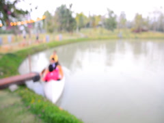 Blurred lake with canoe and family Stock Footage