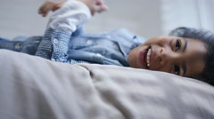 4K Happy little boy lying down on bed at home - stock footage