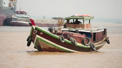 Traditional Myanmar boat view around from other vessel slow motion, Yangon port Stock Footage