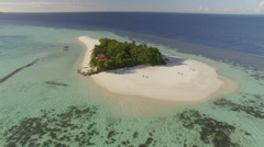 aerial shot of tropical island, Flight over Maldives island - stock footage