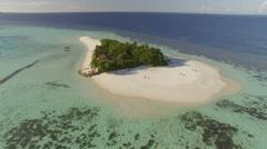 Aerial shot of tropical island, Flight over Maldives island Stock Footage