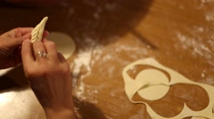 From above woman's hands preparing ravioli on a wooden table. Stock Footage