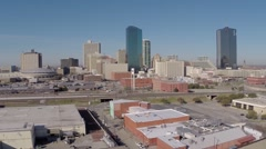Fort Worth aerial camera rises from business park to reveal skyline Stock Footage