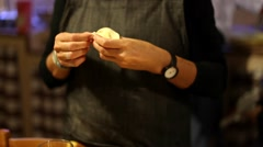 Woman preparing ravioli. Closing the dishes of dough pasta with hands. Stock Footage