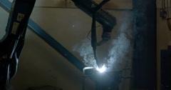 Debris of the welding machine throwing away - stock footage