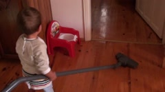 Two years old child is vacuum cleaning 2 - stock footage