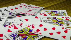 Playing Cards Moving and Rotate on a Wooden Table Stock Footage