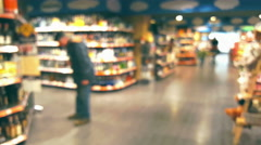 Supermarket store interior with customers, blurred background Stock Footage