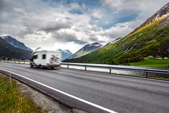 Caravan car travels on the highway. - stock photo