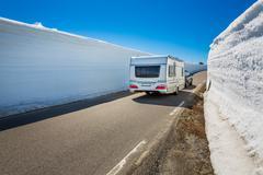 Caravan car travels on the highway. - stock photo