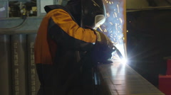 The worker carefully using the welding machine Stock Footage