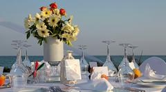 Beach Wedding Decor Table Setting and Flowers - stock photo