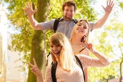 Three happy young people friends outdoor. - stock photo