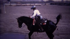 1967: Horse jumps over water obstacle course and crosses bridge. Stock Footage