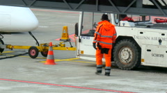 An airport traffic man getting off the cone Stock Footage