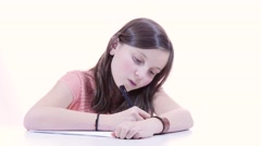 a young schoolgirl writing and receives balls paper - stock footage