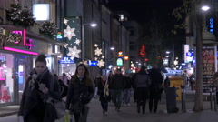 Walking on Breite Gasse, passing by T Mobile store on Christmas, Nuremberg - stock footage