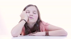 a young girl student asleep on his desk - stock footage