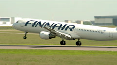 The Finnair airplane successfully lands Stock Footage