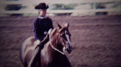 1967: Girl horse riding competition rider trotting around track. - stock footage