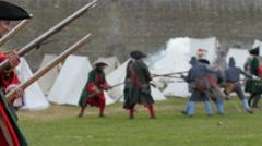 Men in medieval soldier customes walking by Stock Footage