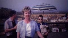 1967: Family at pumpkin farmers market roadside farmstand. Stock Footage