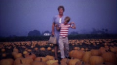 1967: Mother son at farmstand ripe pumpkin vegetable patch. Stock Footage