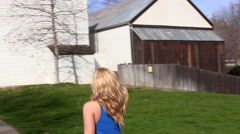 Blond Woman In Blue Dress Walking Outdoors Stock Footage
