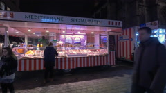 Mediterranean specialties at the Children's Christmas Market, Nuremberg Stock Footage