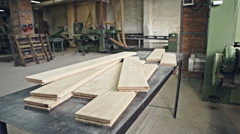 Hardwood lumber stacked on the table. Woodworking for interior carpentry. RAW - stock footage