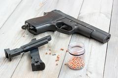 Black pneumatic gun on a floor. - stock photo