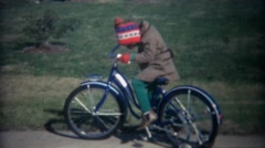 1962: Kids riding new oversized adult sized training wheel bikes. - stock footage