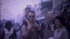 1962: Family visits world famous boardwalk commercial stores. Stock Footage