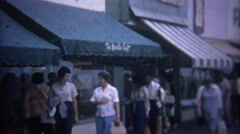 1962: Shoppers walking past boardwalk The Needlecraft store. Stock Footage