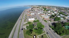 Aerial view over residential area in Rimouski on St Lawrence River 1 Stock Footage