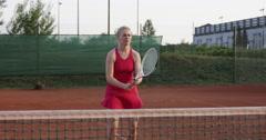 4K Slow-Mo Of Female Tennis Player Enjoying A Game Of Tennis Stock Footage