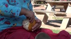 Zoom out toddler littering mandarin skin - stock footage